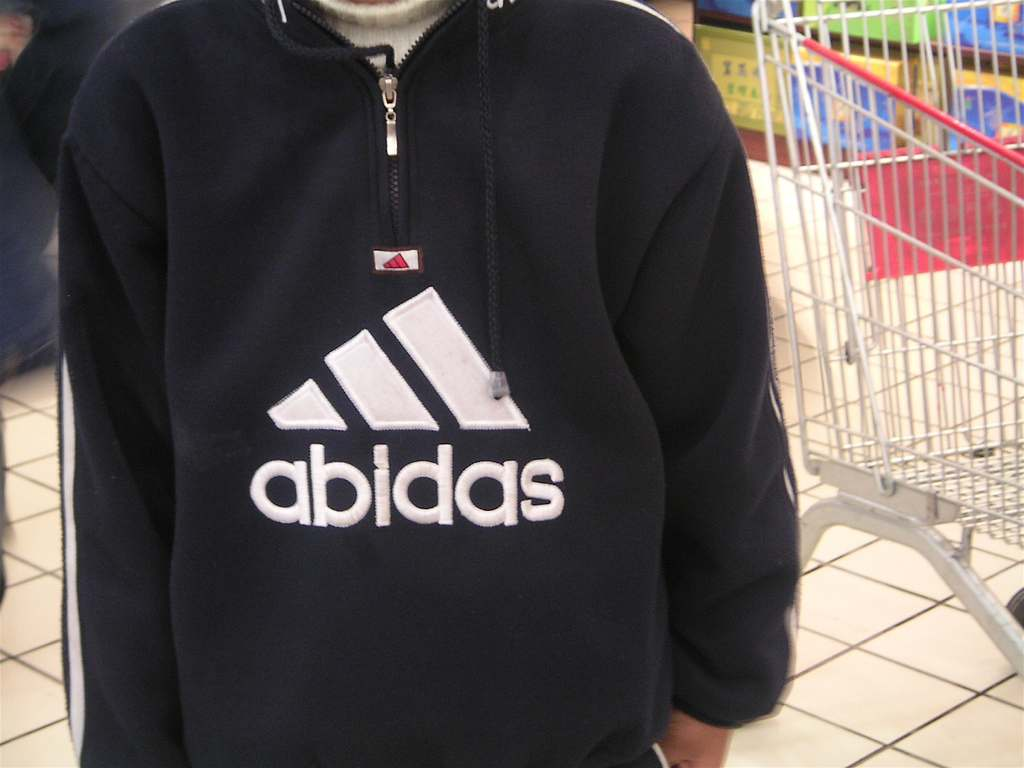 "A fake Adidas sweatshirt in China that reads ""abidas"""