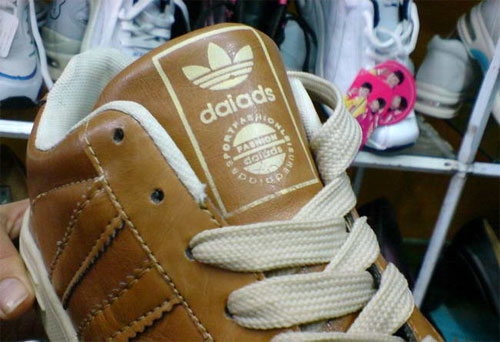 "Fake Adidas shoes in China that read ""daiads"""