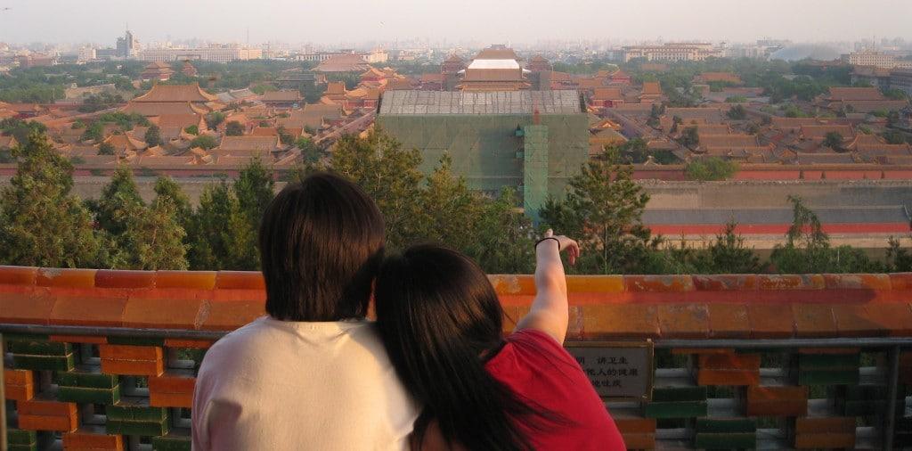Couple sits overlooking Beijing