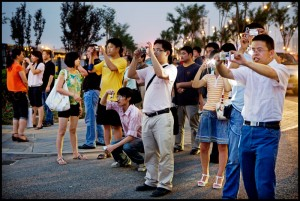 china crowd of chinese tourists taking photo pictures