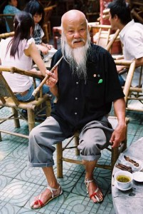 china travel tourists old man relaxing tea pipe