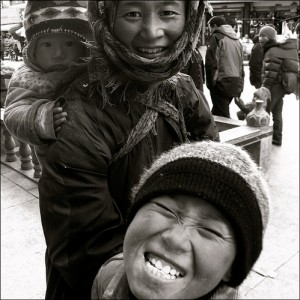 smiling tibetan boy with mother baby street scene lhasa