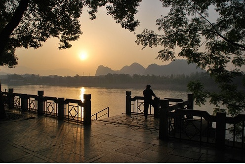 China tourists enjoying sunset li river guilin
