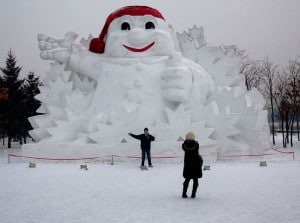 china harbin chinese tourists taking photo giant snowman