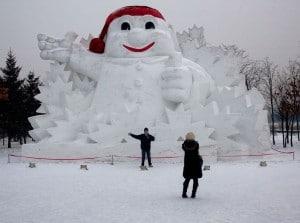 china harbin chinese tourists taking photo giant snowman
