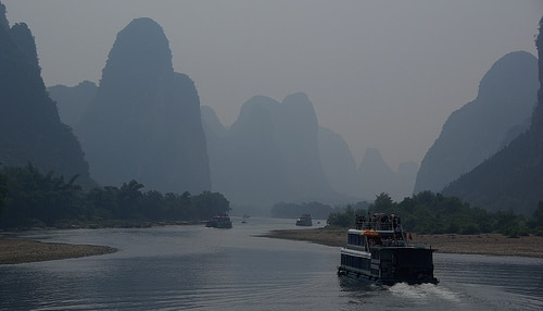 An old ferry boat sailing down the Li River