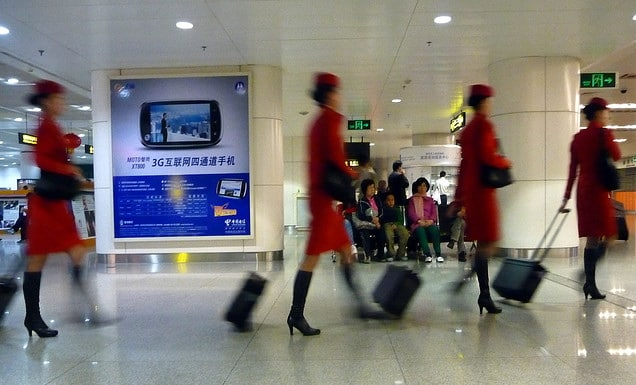 Chinese airline attendants walking to their next destination