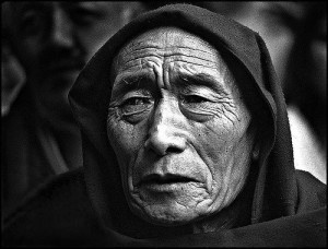 old tibetan monk in lhasa tibet