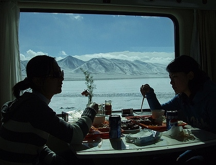 chinese tourists riding train to lhasa