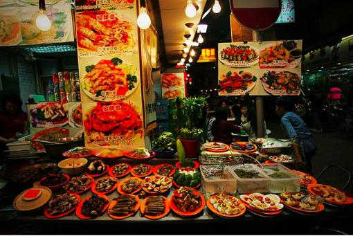A street stand with food displayed in Chengdu
