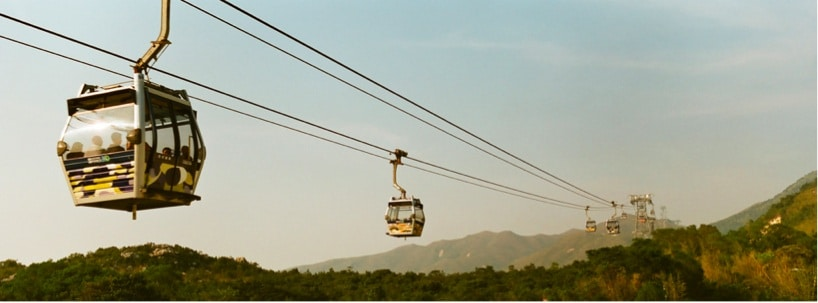 People riding a scenic chair lift