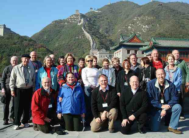 Organized tour group in China, taking a picture on the Great Wall.