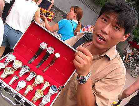 Chinese man holds a set of silverware to try to sell