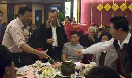 A Chinese toasting game at a restaurant