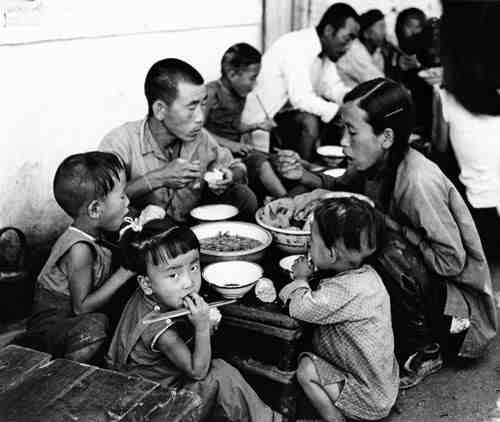Chinese family eating a meal together