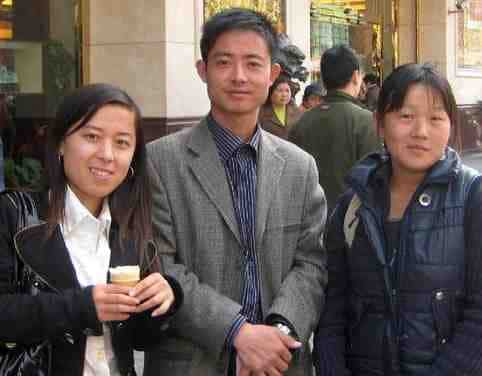 3 older looking college students who are actually Chinese scammers