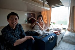 A Chinese couple in soft sleepers on a bullet train