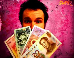 A man holding Renminbi bills