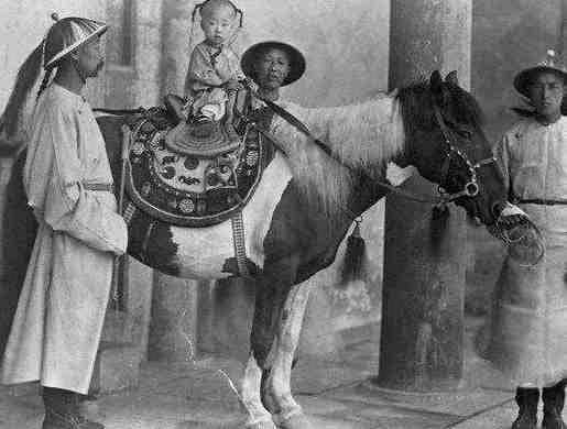 Historical photo of a boy on a horse in China
