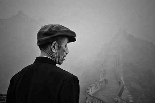 A Chinese man overlooks the Great Wall of China