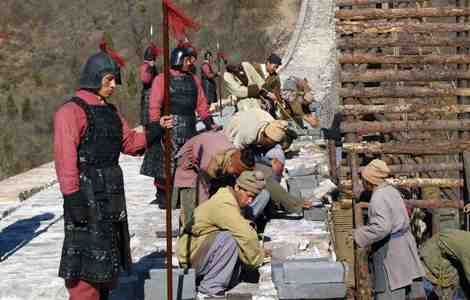A reenactment of the construction of the Great Wall of China using thousands of laborers.