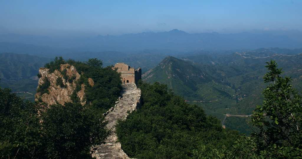 A view of the Great Wall with mountains in the background