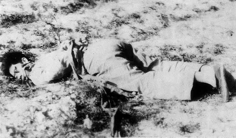 A dead Chinese body lying on the ground