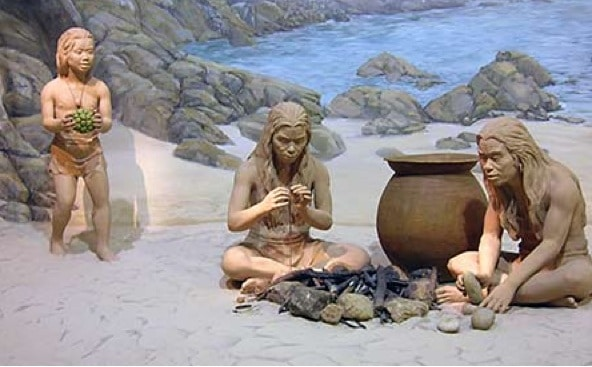 A photo of a family during stoneage times.