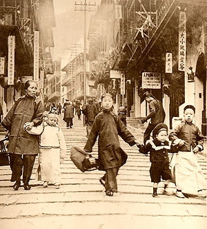 A Chinese family holding hands in the street