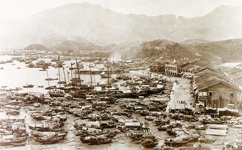 An old photo of a Chinese port with a fleet of boats