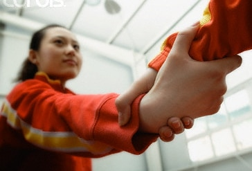 Grabbing the hand of a Chinese person