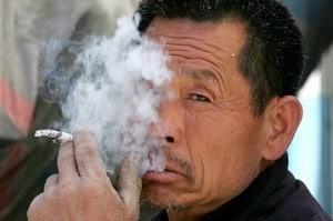chinese man smoking 300x199 GUANXI: The oil that keeps China running