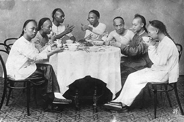Chinese men around a banquet table