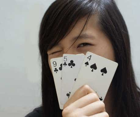 A Chinese woman playing poker