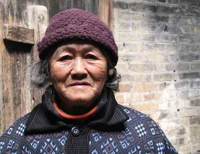 A beautiful but unsmiling Chinese woman