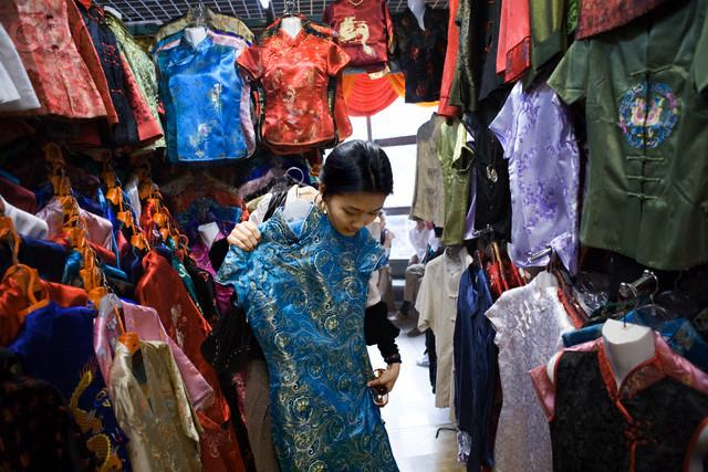 Chinese woman shopping in Beijing's Silk Market