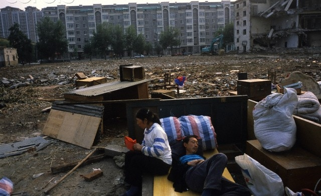 A rather sad picture, showing a homeless Chinese couple living on the streets