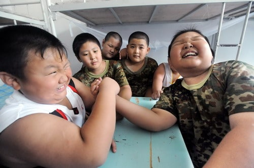 Obese Chinese children playing arm wrestling