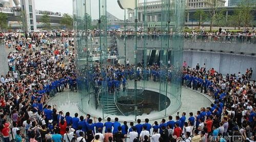 A crowd gathered around an Apple retail store in Shanghai.