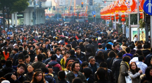 A Chinese crowd in the street