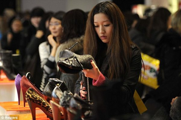 A Chinese woman shopping for shoes