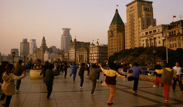 Elderly Chinese doing tai chi on the Bund in Shanghai, one view of health in China.