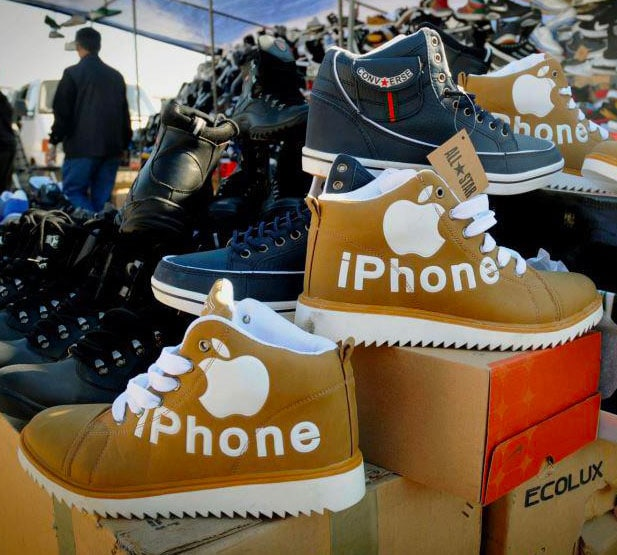 "Pile of shoes with Apple ""iPhone"" branded shoes zoomed in"