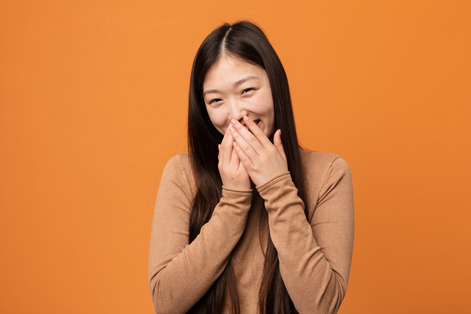 Chinese lady laughing at something funny