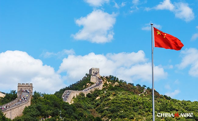 Great Wall of China with the Chinese Flag